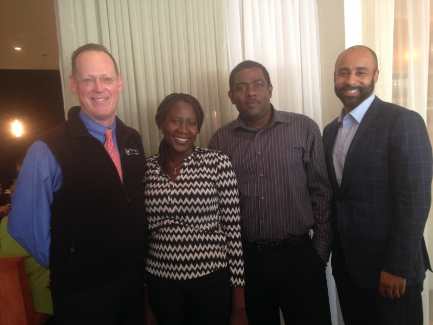 From left: Paul Farmer, Walton Fellows Jasmine Valcourt and Arklin Dumeny, and David Walton