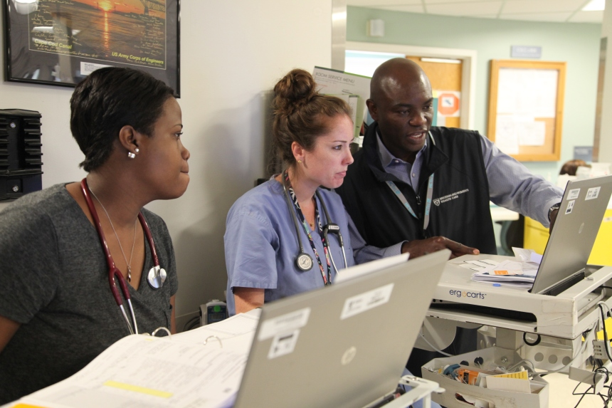 BWH nurses Chantal Cayo (at left) and Katie Labella go through an Epic tutorial with Sam Sanni, of health care solutions company HCTec.