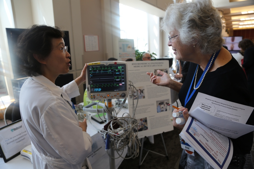 From left: Xiaojie Liu, of Biomedical Engineering, and Brenda Griffin, of Nursing, at BWH's Joint Commission Readiness Fair last September.
