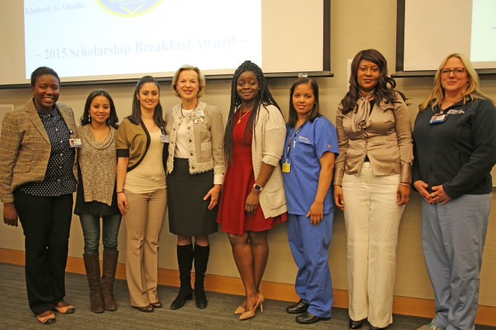 BWH President Betsy Nabel (fourth from left) with AMMP awardees (from left) Eunice Charles, Kimberly Olmilla, Lucy Kirakous, Maxine Rose, Loren Valdez, Rhonda Glenn and Deborah Sitter. Not pictured: Award recipient Jahkia Yancey.