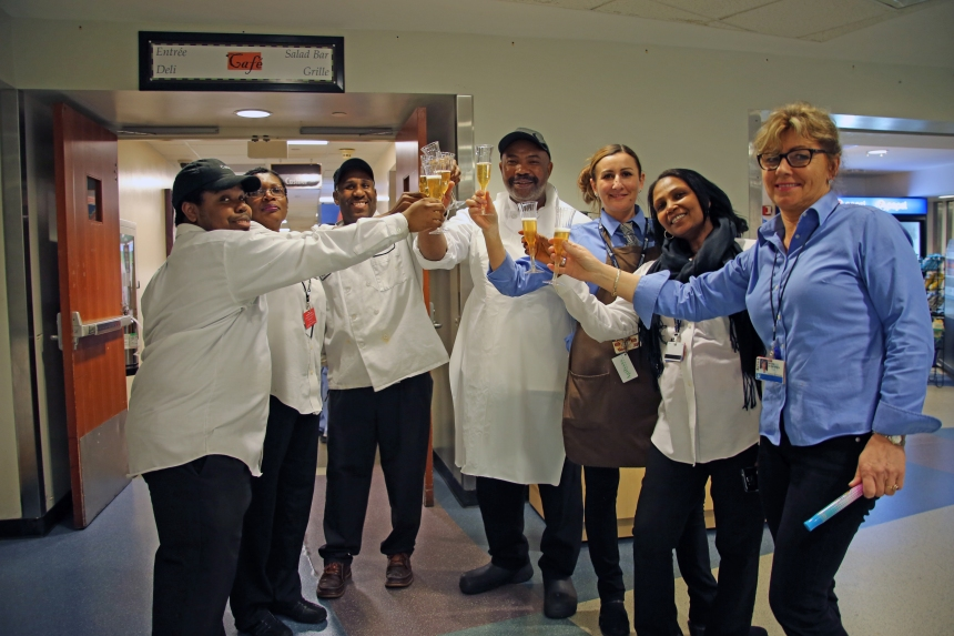 Food Services staff celebrate the end of one BWH Cafeteria chapter and toast with sparkling cider to the next.