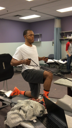 Anthony Hodges practicing rehabilitation exercises