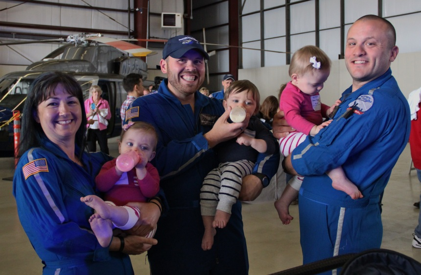 From left: Triplets Paige, Christian and Emma reunite with the MedFlight Boston team (Jennifer Park, David Derosier and Andrew Gordon) who transported them from BWH's NICU.