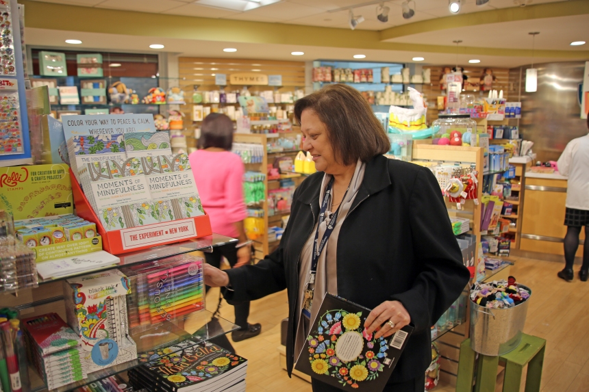 Therese Breen selects gifts at the Shop on the Pike to donate to the Toys for Tots program.