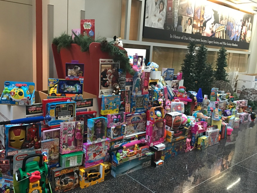 A sleigh in the main lobby overflows with donations for Toys for Tots.