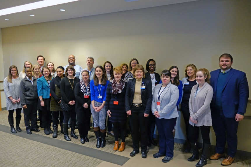 Members of the Lean Practitioner Program gather for a group photo after delivering their final presentations.