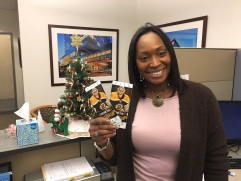 Bronte Lambert shows off Boston Bruins tickets she won as a raffle prize by donating to BWH's United Way campaign.