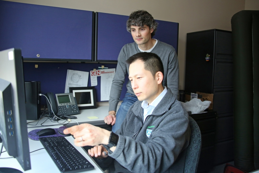 Michael Cho (foreground) and Brian Hobbs examine their data on COPD.