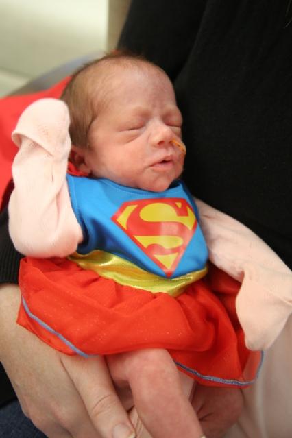 Twin Emily as Superwoman
